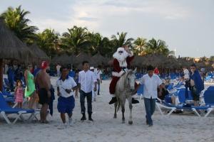 Santa arriving by donkey