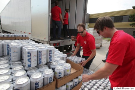 Labatt donates 30 palettes of water to the Calgary Drop In Centre in Calgary, Alberta, Monday, June 24, 2013. Photo by Mike Ridewood